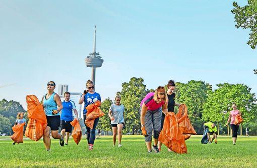 Am Weltumwelttag waren viele Plogger – wie in Köln – unterwegs. Foto: imago stock&people