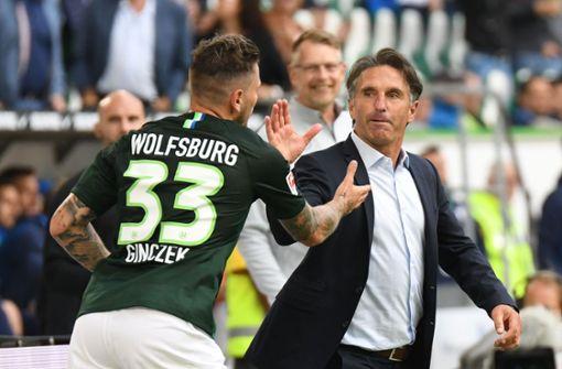 Daniel Ginczek und Bruno Labbadia – zwei mit VfB-Vergangenheit führen den VfL Wolfsburg zurück in die Bundesligaspitze. Foto: dpa