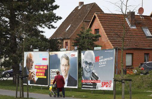Wahlplakate in Kiel mit Wolfgang Kubicki (FDP), Daniel Günther (CDU) und Torsten Albig (SPD) Foto: dpa