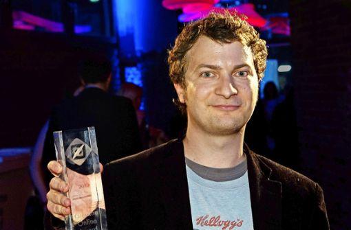 Stefan Sichermann nimmt 2013 den Grimme-Online-Award entgegen Foto: dpa