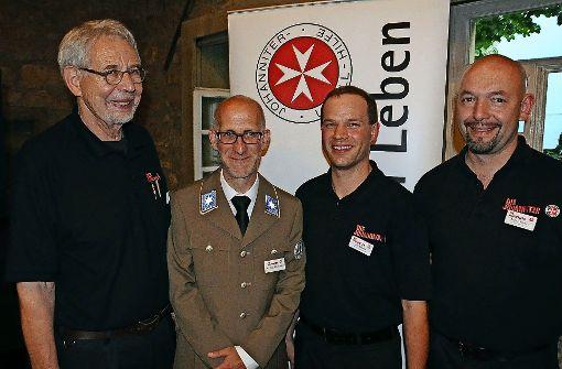 Bei der Feier wurden erstmals auch  Aktive geehrt: Herbert Grässer, Martin Merz (Leiter), Ralf Oberfell und Andreas Riechert (von links). Foto: Georg Linsenmann