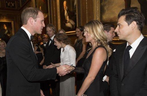Prinz William (links) mit Model Kate Moss und ihrem Ehemann Jamie Hince Foto: Getty Images Europe