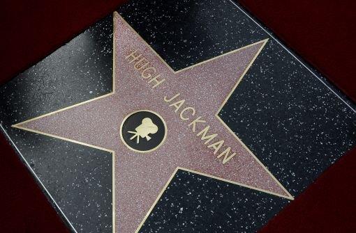 ... einen Stern auf dem berühmten Walk of Fame. Foto: dpa
