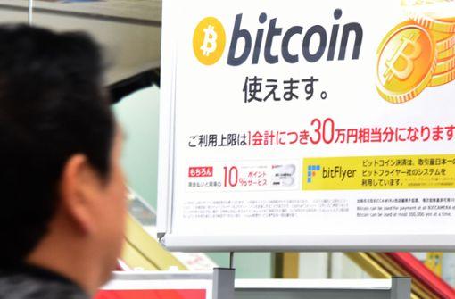 In Asien sind Bitcoin und Co. sehr beliebt – hier ein Bild aus Tokio. Foto: AFP