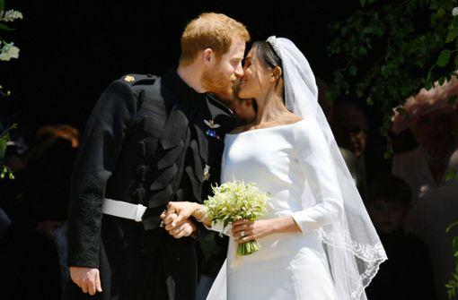 Ein erster Kuss als Mann und Frau: Prinz Harry und Meghan Markle an ihrem Hochzeitstag. Foto: POOL
