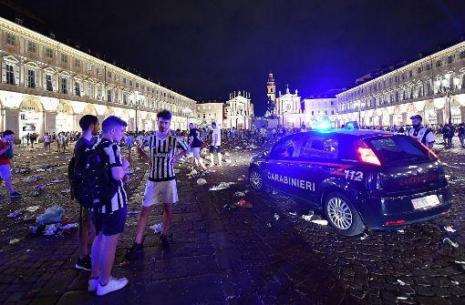 Tausende Fans von Juventus Turin gerieten beim Public Viewing in ihrer Stadt in Panik. Foto: dpa