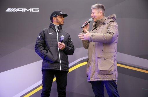 Lewis Hamilton mit RTL-Moderator Heiko Waßer. Foto: Pressefoto Baumann