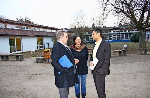 Umweltminister Franz Untersteller (l.) im Gespräch mit den  Rektoren Claudia Neulinger und Philipp Malhotra. Foto: Chris Lederer