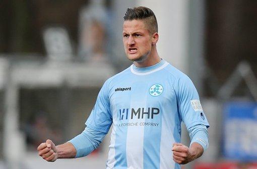Ging  mit gutem Beispiel voran und feuerte sein Team lautstark an: Hendrik Starostzik   Foto:  Baumann Foto: