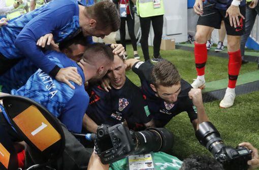 Emotionen pur bei den kroatischen Spielern – und Bilder eines Fotografen für die Ewigkeit. Foto: AP