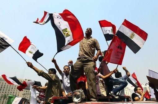 Breite Unterstützung der Bevölkerung: Unterstützer der ägyptischen Muslimbrüder demonstrieren auf dem Tahrir-Platz in Kairo für Foto: EPA