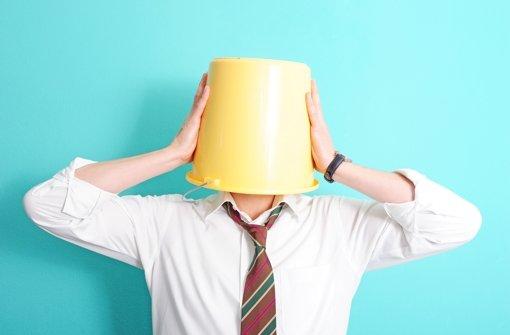 Ein Mann mit einem Giebel auf dem Kopf. Foto: dpa