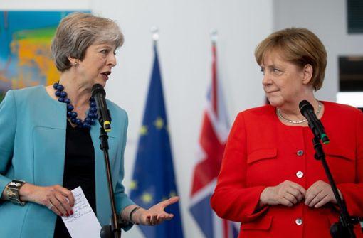 May trifft sich mit Merkel und Rutte