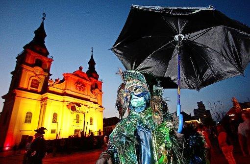 Insgesamt 1200 Kostümträger flanierten während der Venezianischen Messe über den Marktplatz in Ludwigsburg. Foto: factum/Granville