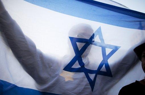 Seit 1948 ist der Davidstern das Emblem der Nationalflagge des neu gegründeten Staates Israel – in Deutschland nutzen Neonazis das sechszackige Symbol zu Boykott-Aufrufen. Foto: Getty
