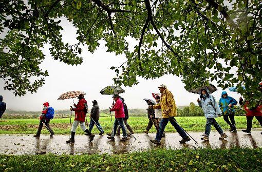 Die Sportler lassen sich vom Regen nicht entmutigen