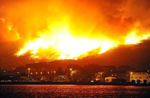 In der Nähe des kroatischen Dorfs Podstrana wüten schwere Waldbrände. Foto: AFP