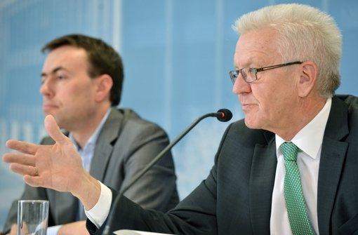 Winfried Kretschmann und Nils Schmid werden vor der Landtagswahl an Diskussionsrunden der StN und der StZ mit der AfD teilnehmen Foto: dpa