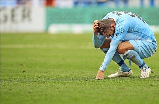 Nach dem 0:3 in Aalen: Bajram Nebihi enttäuscht am Boden Foto: Baumann