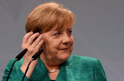 Merkel sagt Randale-Opfern Entschädigung zu