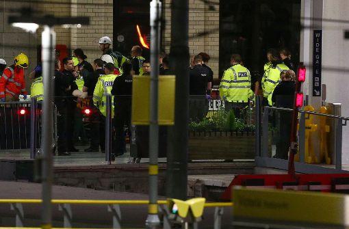 Blutüberströmte Menschen in Arena von Manchester