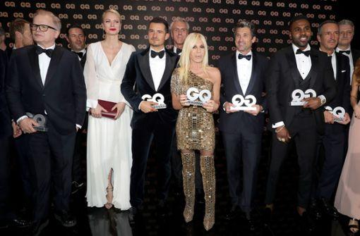 Nicht nur Männer wurden ausgezeichnet – auch Donatella Versace freute sich über ihre Ehrung. Foto: Getty Images Europe
