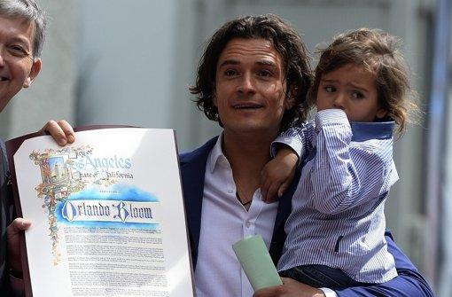 Mit Sohn Flynn auf dem Walk of Fame
