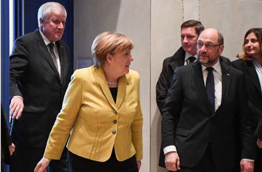 Merkel verspricht zügige Sondierungen