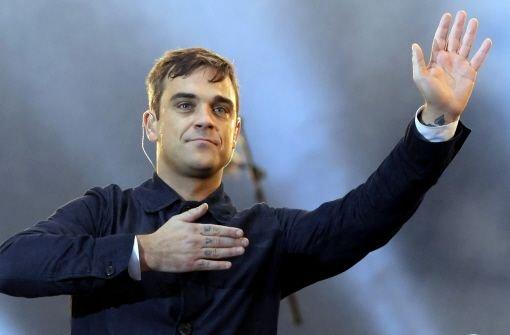 Er ist zurück: Am 11. August tritt Robbie Williams in Stuttgart auf. Foto: dpa