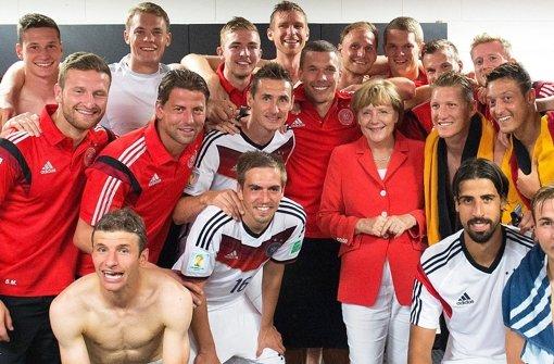 Gruppenfoto mit Merkel in der Kabine