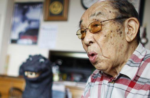Der Mann im Godzilla-Kostüm